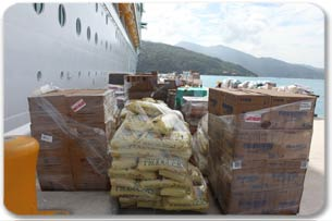 Pallets waiting to be loaded on to a truck to be distributed in Haiti.