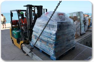 Forklift unloading relief supplies for Royal Caribbean